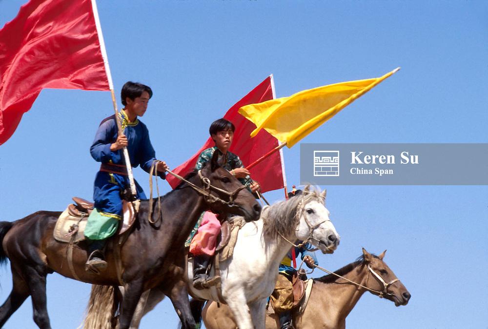 Mongolian herdsmen horse racing at the Nadaam Festival, Inner Mongolia, China