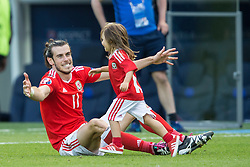 PARIS, FRANCE - Saturday, June 25, 2016: Wales' Gareth Bale plays on the pitch with his daughter Alba after victory in the Round of 16 UEFA Euro 2016 Championship match  against Northern Ireland at the Parc des Princes. (Pic by Paul Greenwood/Propaganda)