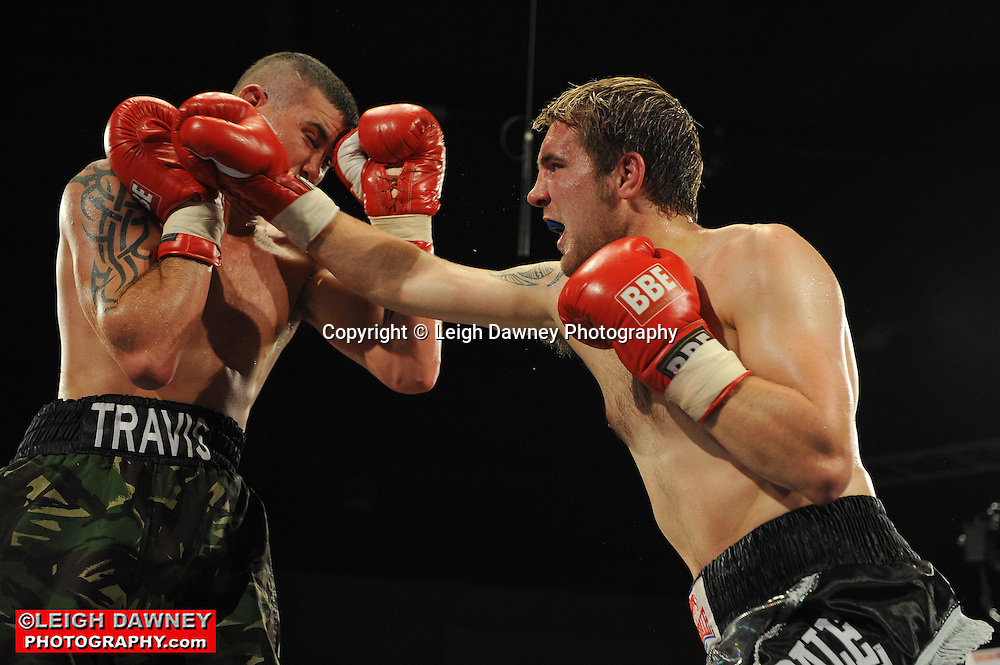 Travis Dickinson (camouflage shorts)) defeats Shon Davies at Rainton Meadows Arena, Sunderland, 11th September 2010. Frank Maloney Promotions. © Photo credit: Leigh Dawney