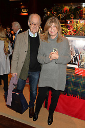 JOHN & SARAH STANDING at a party to celebrate the publication of 'A Designer's Life' by Nicky Haslam held at Ralph Lauren, 1 New Bond Street, London on 19th November 2014.