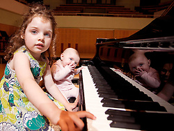 Repro Free: 28/08/2012.Sisters Caraleigh (aged 4) and Corbyn Rose Doyle (aged 3 months) try out the Steinway Grand Piano at The National Concert Hall in advance of MiniMusic starting in September. MiniMusic is an action-packed music workshop experience for babies and young children aged 3 months to 5 years old which runs for 10 weeks at The National Concert Hall. More information on nch.ie?. Pic Jason Clarke Photography.