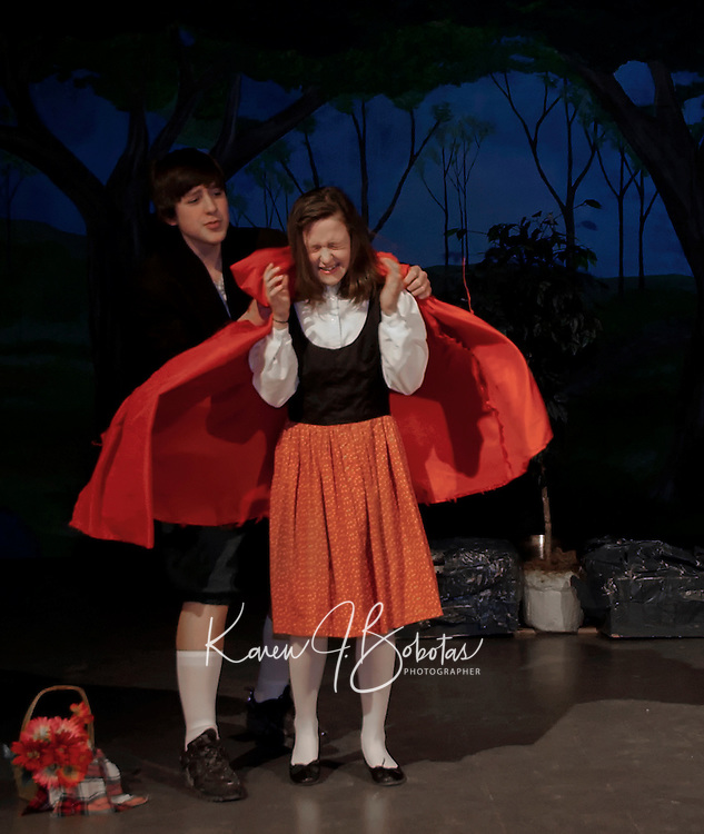 "The Baker played by Michael O'Brien tries to console Little Red Riding Hood played by Emily Paronto during dress rehearsal for ""Into The Woods"" at Laconia Middle School Wednesday afternoon.  (Karen Bobotas/for the Laconia Daily Sun)"