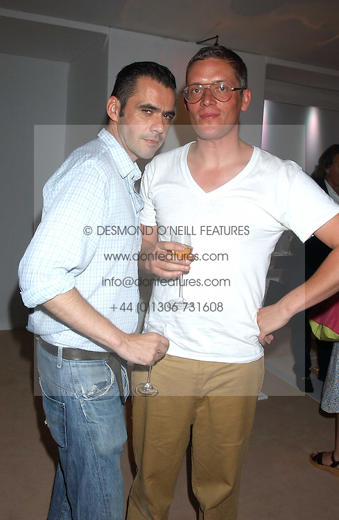 Left to right, fashion designers ROLAND MOURET and GILES DEACON at a summer party hosted by champagne house Krug held at Debbenham House, 8 Addison Road, London on 28th June 2005.<br />