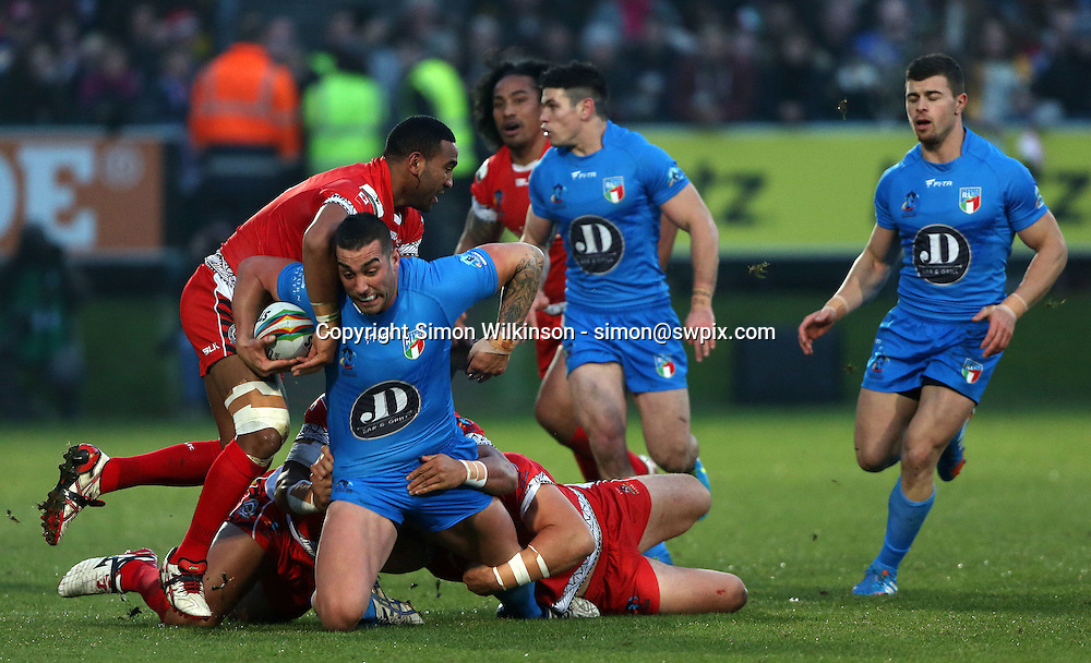 Picture by Vaughn Ridley/SWpix.com - 10/11/2013 - Rugby League - Rugby League World Cup - Tonga v Italy - the Shay Stadium, Halifax, England - Italy's Paul Vaughan is tackled by Tonga's Samsoni Langi and Willie Manu.