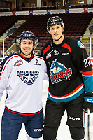 KELOWNA, CANADA - DECEMBER 5: Parker AuCoin #32 of the Tri-City Americans stands at centre ice with Braydyn Chizen #22 of the Kelowna Rockets  on December 5, 2018 at Prospera Place in Kelowna, British Columbia, Canada.  (Photo by Marissa Baecker/Shoot the Breeze)