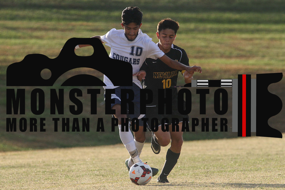 Delcastle Midfield Edgar Rossier-Estrada (10) battles Newark Forward Diego Guzman (10) for the ball during a regular season soccer match between Newark and Delcastle Thursday, Oct. 22, 2015 at Delcastle in Wilmington.