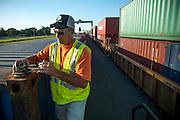 Georgia Ports Authority workers operate RTG's at the Chatham Rail Inter-model facility, Tuesday July 29, 2014, at the Garden City Terminal near Savannah, Ga.  (GPA Photo/Stephen B. Morton)