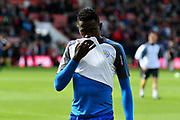 Wilfred Ndidi (25) of Leicester City wipes his nose on his shirt while warming up before the Premier League match between Bournemouth and Leicester City at the Vitality Stadium, Bournemouth, England on 30 September 2017. Photo by Graham Hunt.