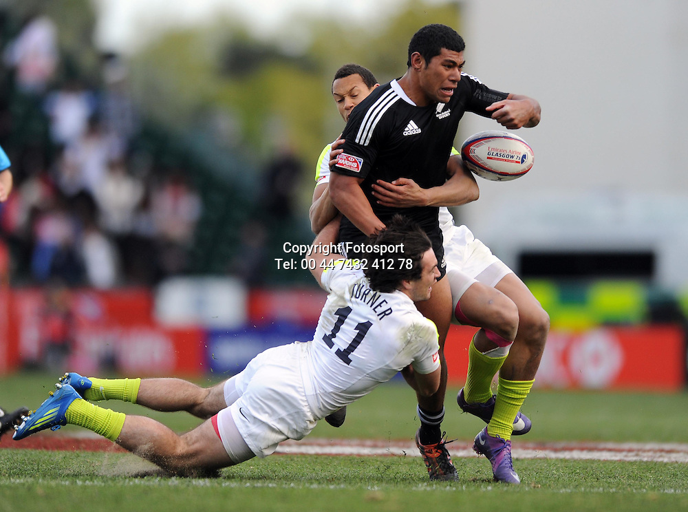 New Zealand's Salesi Piutau is tackled by England's Mat Turner.<br /> New Zealand v England, Cup Final, IRB Sevens World Series, round 8, Day 2, Scotstoun Stadium, Glasgow, Scotland, Sunday 6th May 2012.<br /> PLEASE CREDIT ***FOTOSPORT/DAVID GIBSON***
