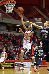 08 March 2008: Tiffany Hudson gets position on Shannon Novosel for a lay up. The University of Evansville Purple Aces and the Illinois State University Redbirds took the court looking for the MVC season title, but the Redbird win (87-72) split the title.  The game was played on Doug Collins Court in Redbird Arena in Normal Illinois.