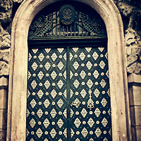 atmospheric photo of and old doorway in Prague in sepia tone