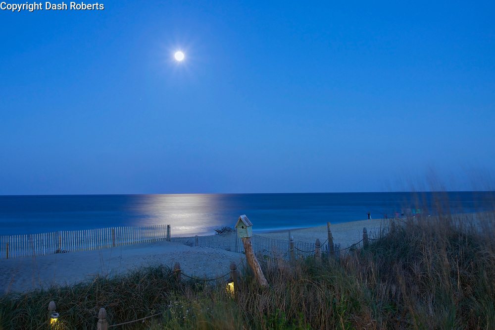 Moon shines over beach in Rodanthe, North Carolina.