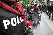 Police standing guard during the Red Shirts anti-government protest in the Silom area of Bangkok were given flowers by area workers.