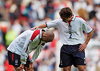 Fotball<br /> Foto: SBI/Digitalsport<br /> NORWAY ONLY<br /> <br /> England v Wales<br /> 09.10.2004<br /> <br /> England's Gary Neville (R) checks on his good friend David Beckham who pulled up with an injury on the stroke of half time.