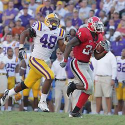 25 October 2008:  Georgia running back Knowshon Moreno (24) runs away from LSU defender LSU linebacker Darry Beckwith (48) during the Georgia Bulldogs versus the LSU Tigers game at Tiger Stadium in Baton Rouge, LA.