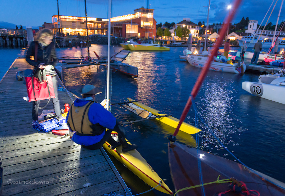 Racers do final preparation for the start of the race, at about 4am under the moonlight.<br />