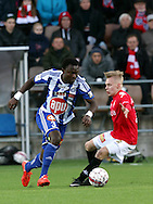 23.4.2015, Sonera Stadion, Helsinki.<br /> Veikkausliiga 2015.<br /> Helsingfors IFK - Helsingin Jalkapalloklubi.<br /> Gideon Baah (HJK) v Jesse Ahonen (HIFK).