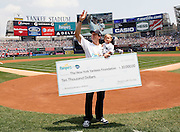 NEW YORK, JUNE 20: High performance dad and Superbowl XLIV MVP Drew Brees, alongside his best player, 1-year-old son Baylen, present a donation to The Yankees Foundation on behalf of Pampers with Dry Max during Sunday's Father's Day game, New York, Sunday, June 20, 2010. (Photo Stuart Ramson / PictureGroup)