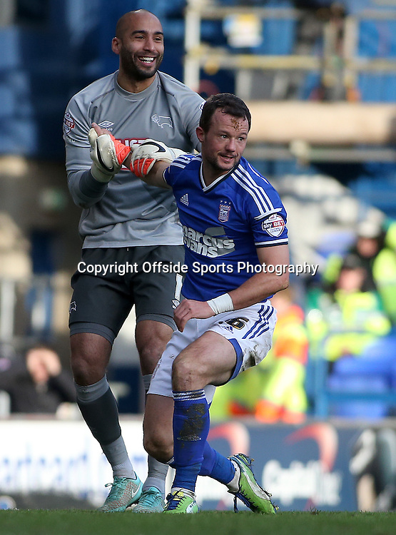 10 January 2015 - Sky Bet League Championship - Ipswich Town v Derby County - Derby goalkeeper Lee Grant helps up Noel Hunt of Ipswich after he misses a chance late in the game.<br /> <br /> Photo: Ryan Smyth/Offside