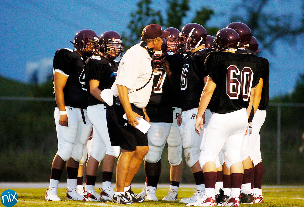 Jay M. Robinson head coach Bobby Cloninger talks with his players during a time out during a game against Northwest Cabarrus Friday, August 22, 2008. Northwest Cabarrus won the game 31-7. (photo by James Nix)