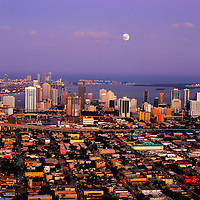 Aerial view of moonrise over the downtown Miami skyline looking east including Brickell Avenue.