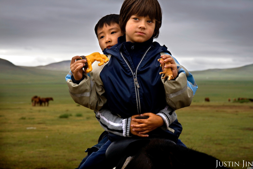 Autistic child Rowan, 5, communicates with six-year-old Bodibilguunson. He is the son of Mongolia guide. .Rowan is riding a horse in Mongolia, accompanied by his parents Rupert and Kristin..Rowan's parents believe horses and shamans can unlock their son's autistic mind. This is their journey of discovery across Mongolia on horseback. .The story is published by the Sunday Times and accompany text by Tim Rayment.