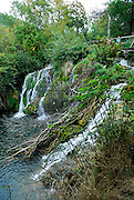 Bridge and walkway over waterfall, Krka National Park, Croatia