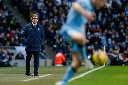 Manchester City Manager Manuel Pellegrini looks on - Photo mandatory by-line: Rogan Thomson/JMP - 07966 386802 - 18/01/2015 - SPORT - FOOTBALL - Manchester, England - Etihad Stadium - Manchester City v Arsenal - Barclays Premier League.
