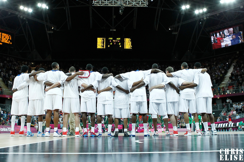 06 August 2012: Team France stands during the National Anthem prior to the 79-73 Team France victory over Team Nigeria, during the men's basketball preliminary, at the Basketball Arena, in London, Great Britain.