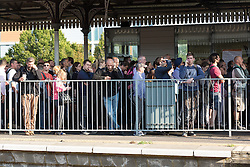 © Licensed to London News Pictures. 09/07/2015. London, UK. Passengers are held behind crowd control barriers at Clapham Junction station in south London. A tube strike today has closed the TfL London Underground network and has been called by Trade Unions in protest over the new all-night tube trains, due to start in mid-September.. Photo credit : Vickie Flores/LNP