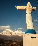 Huascaran, two summits, 6768 metres, highest peak in Cordillera Blanca, above city of Yungay memorial garden and statue of Christ for 50,000 victims of 1970 avalanche, near Huaraz, Andes mountains, Peru