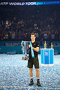 Andy Murray of Great Britain  holds up the ATP Trophy after his Final's match and day eight of the Barclays ATP World Tour Finals at the O2 Arena, London, United Kingdom on 20 November 2016. Photo by Martin Cole.