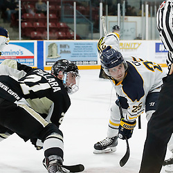 TRENTON, ON - NOV 10:  Jeremy Pullara #21 of the Trenton Golden Hawks and Ryan Cox #25 of the Buffalo Jr. Sabres at the face-off during the OJHL regular season game between the  Buffalo Jr Sabres and Trenton Golden Hawks on November 10, 2016 in Trenton, Ontario. (Photo by Amy Deroche/OJHL Images)