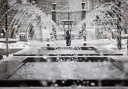 A man walks past the Temple Square gates in Downtown Salt Lake City as snow continues to fall, Friday, Dec. 28, 2012.