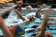 Foothill's Kathryn Bustard, center, leaves the starting block with the rest of the participants in the girls 200 yard medley relay during Saturday's 35th Annual Foothill Swim games.