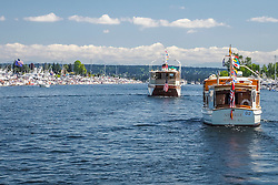 United States, Washington, Seattle. Opening Day of Boating Season. Boats head east from Seattle into Lake Washington.