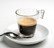 A glass of Espresso on white background