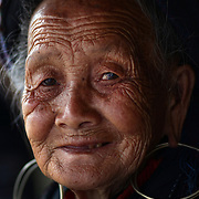 A portrait of an elderly Black Hmong lady at Lao chai village near Sapa, Northern Vietnam. Sapa and the surrounding highlands are close to the Chinese border in Northern Vietnam and is inhabited by highland minorities including Hmong and Dzao groups. Sapa is now a thriving tourist destination for travelers taking the night train from Hanoi. Sapa, Vietnam. 16th March 2012. Photo Tim Clayton