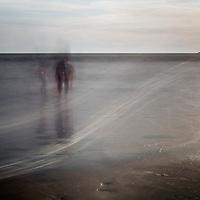 People bathing on the sea, Valdelagrana  beach, El Puerto de Santa Maria, Spain. Daylight long exposure shot by the use of neutral density filters.