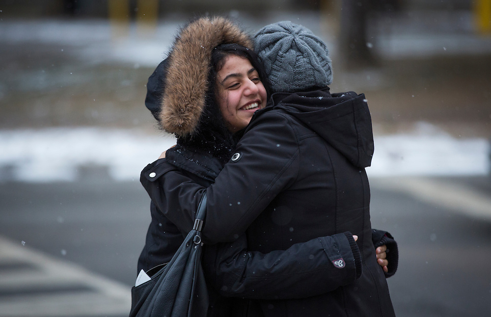 Syrian refugee Rania Batal Al Hasan (left) hugs her english translator in Mississauga, Ontario, Canada, Thursday January 21, 2016.   (Mark Blinch for the BBC)
