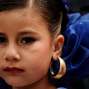 "Saida Martinez, 7, of Los Angeles Calif.,  waits in traditional dress to perform with Ballet Fiesta, a Mexican folkloric dance troupe, in the Plaza Olvera, in Los Angeles, Calif., on April 11, 2009. The group is performing for the annual ""Blessing of the Animals"" event held at the plaza.  Photo by Jen Klewitz"