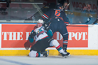 KELOWNA, CANADA - MARCH 25: Dallas Valentine #6 of the Kamloops Blazers checks Nolan Foote #29 of the Kelowna Rockets into the boards during second period on March 25, 2017 at Prospera Place in Kelowna, British Columbia, Canada.  (Photo by Marissa Baecker/Shoot the Breeze)  *** Local Caption ***