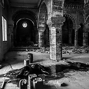 The body of a dead ISIS fighter, doused in gasoline, is found in a Christian church located near the Al Nuri Mosque in Mosul on July 2, 2017. Days after the Iraqi government declared the Islamic State was defeated in Mosul, heavy fighting persisted while newly liberated residents still fled the Old City neighborhood in droves. With temperatures reaching 115 degrees, many needed medical attention for heat exhaustion.