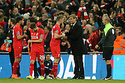 Liverpool Manager Jurgen Klopp  gives Liverpool midfielder Jordan Henderson (14)   some instruction after Liverpool midfielder Philippe Coutinho (10)   goal during the Capital One Cup match between Liverpool and Manchester City at Anfield, Liverpool, England on 28 February 2016. Photo by Simon Davies.