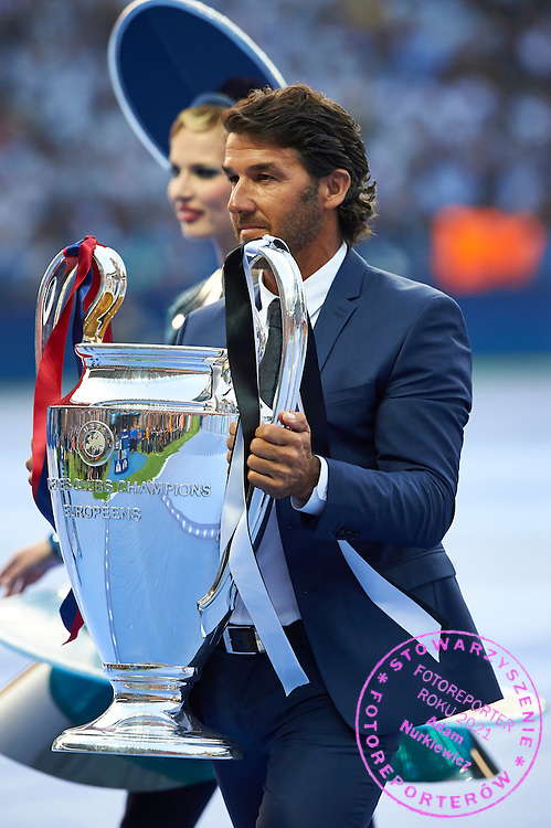 Ambassador Karl-Heinz Riedle parades the trophy during the 2014/15 UEFA Champions League Final between Juventus and FC Barcelona at Olympiastadion on June 6, 2015 in Berlin, Germany.<br /> Germany, Berlin, June 6, 2015<br /> <br /> Picture also available in RAW (NEF) or TIFF format on special request.<br /> <br /> For editorial use only. Any commercial or promotional use requires permission.<br /> <br /> Adam Nurkiewicz declares that he has no rights to the image of people at the photographs of his authorship.<br /> <br /> Mandatory credit:<br /> Photo by &copy; Adam Nurkiewicz / Mediasport
