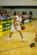 1/13/2006: Junior guard Luke Cooper (14) of the UAA Seawolves sets a play as Alaska Anchorage gets a comeback victory over Northwest Nazarene, 60-57, in men?s basketball action at the Wells Fargo Sports Complex on Saturday.