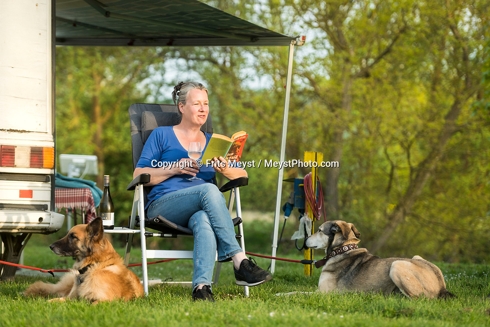 Monzingen, Nahetal, Germany, May 2018. Campers on Camping Nahemuhle ion the banks of the Nahe river in Monzingen. The Nahe region is named after the river that traverses the valleys of the forested Hunsrück Hills as it flows towards the Rhine. A landscape of vineyards, orchards and meadows interspersed with cliffs and striking geological formations. Photo by Frits Meyst / MeystPhoto.com