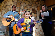 Alison, age 6, is learning to play guitar and participates in creating music for the Spanish Palm Sunday Mass.