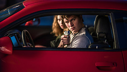 Baby (ANSEL ELGORT) and Debora (LILY JAMES) jack a car to get away in TriStar Pictures' BABY DRIVER.
