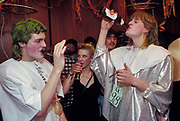Young people drink beers during a fancy dress party in a Liechtenstein village hall, on 8th February 1990, in Gamprin, Liechtenstein.